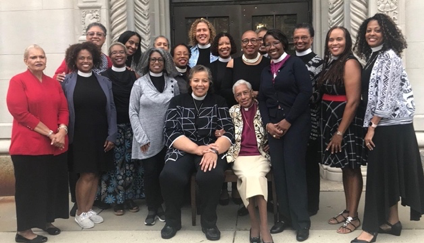 Black clergy women gather the night prior to Bishop Carlye Hughes' (seated on left) consecration in 2018