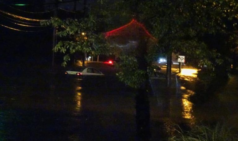 A car is stranded by flood waters at the corner of Ethel Rd. and Stelton Rd. in Piscataway on Sept. 1, 2021. (Photo by Jill Bagley)